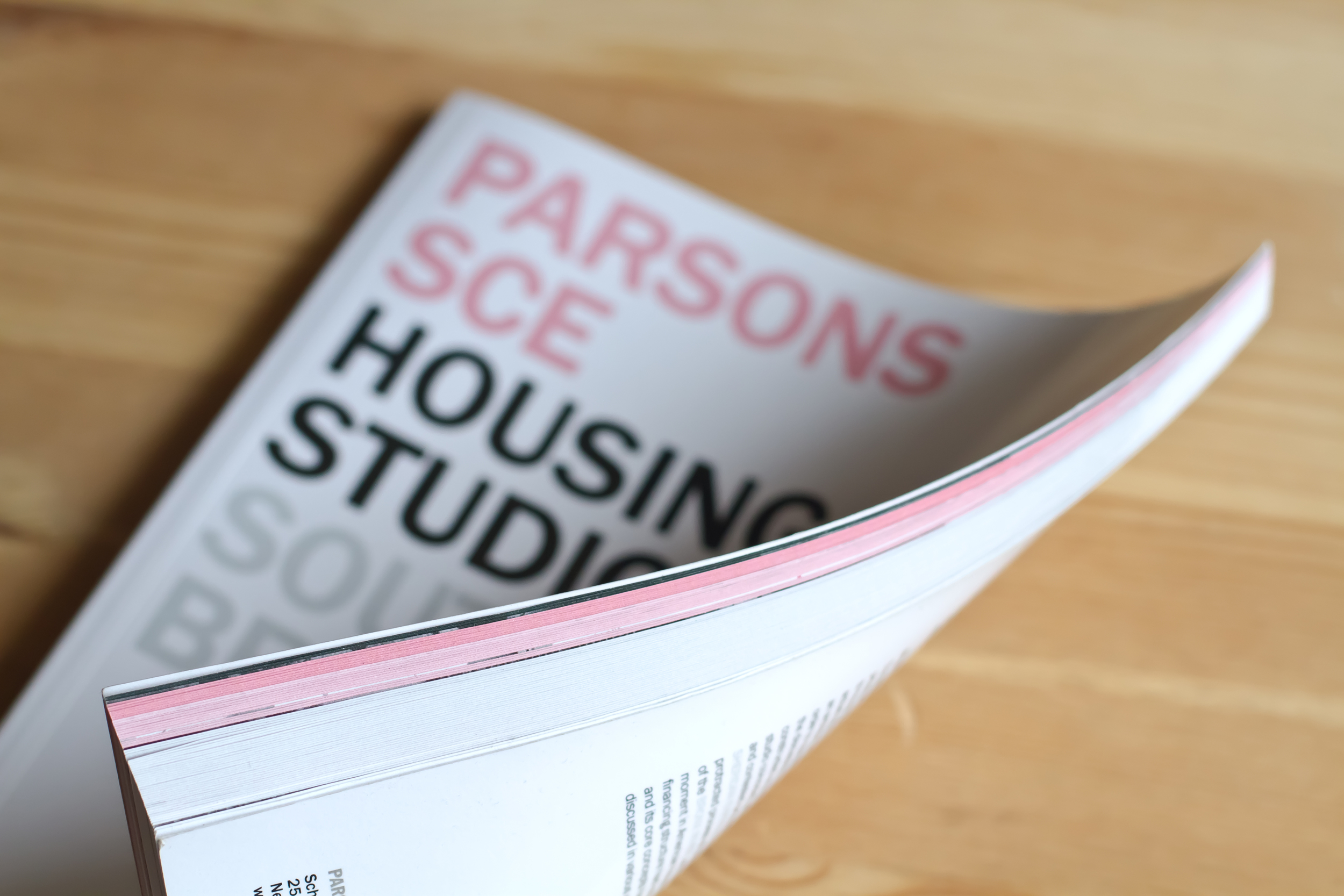 Research pages are identified by a pink edge while student projects are identified with a white edge