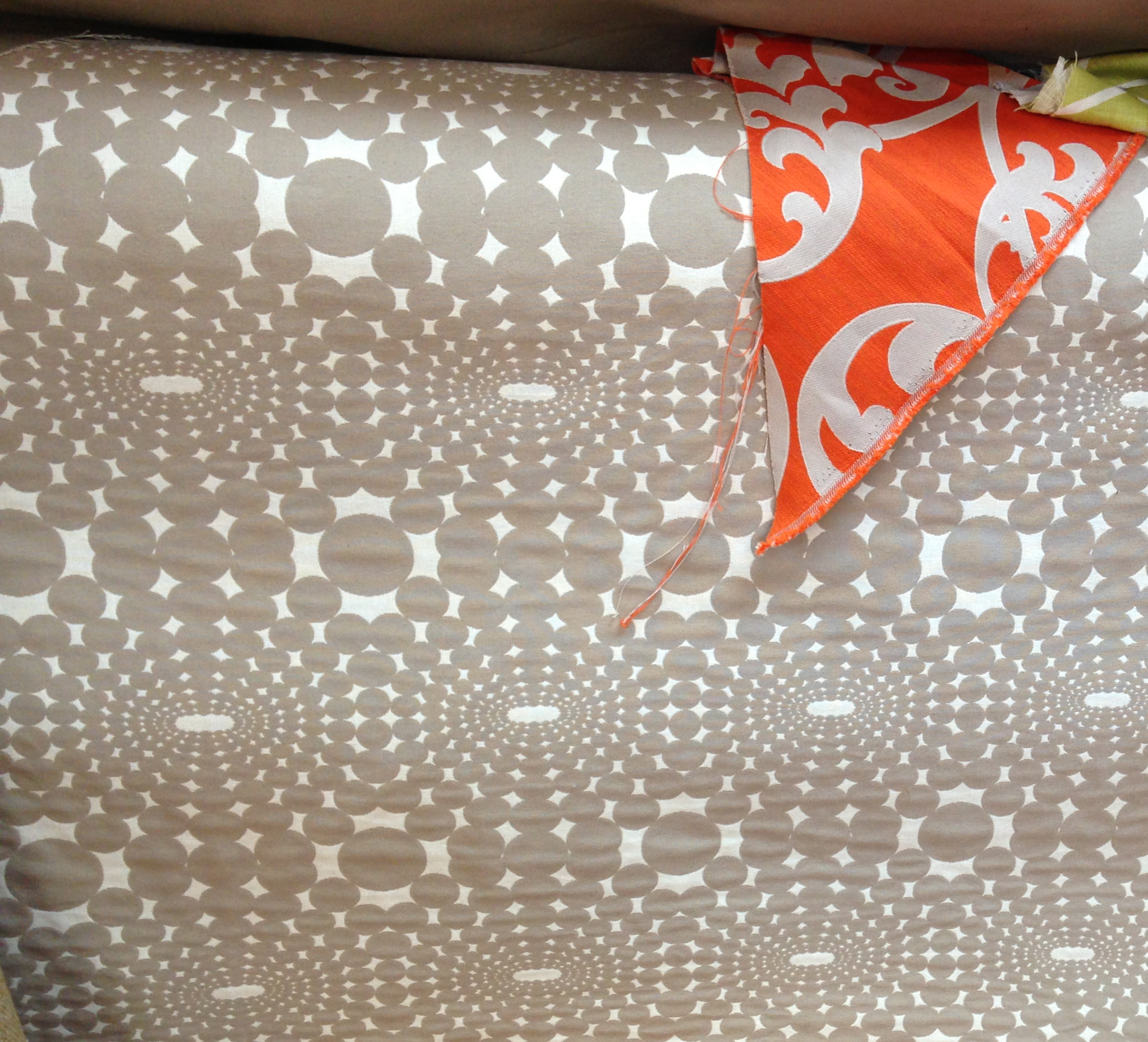 Main fabric for foursome of chairs is the grey circles. The orange print is for the front of the taller 5th chair.