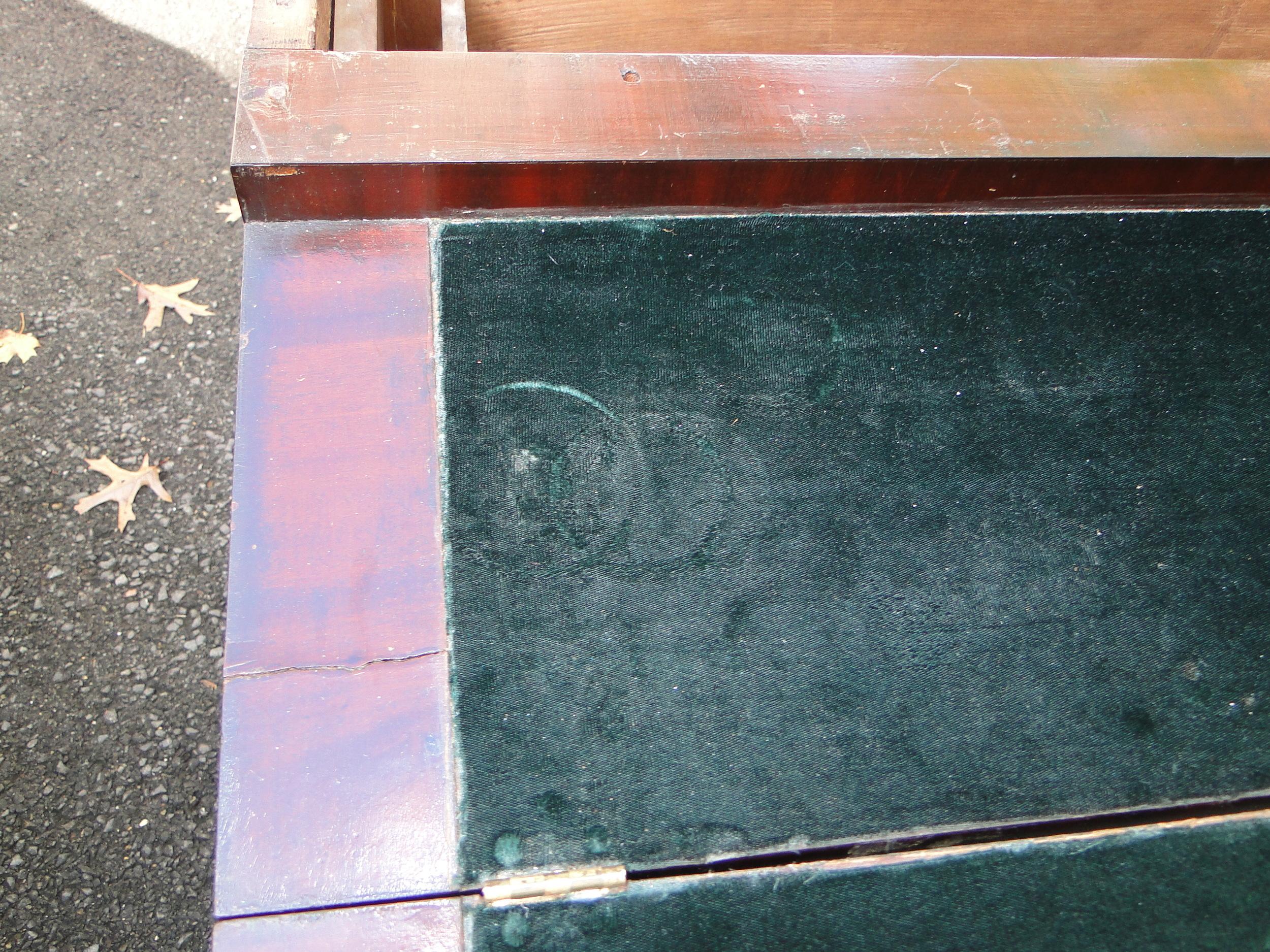 """""""Before"""" view of damaged velvet fabric on desktop"""