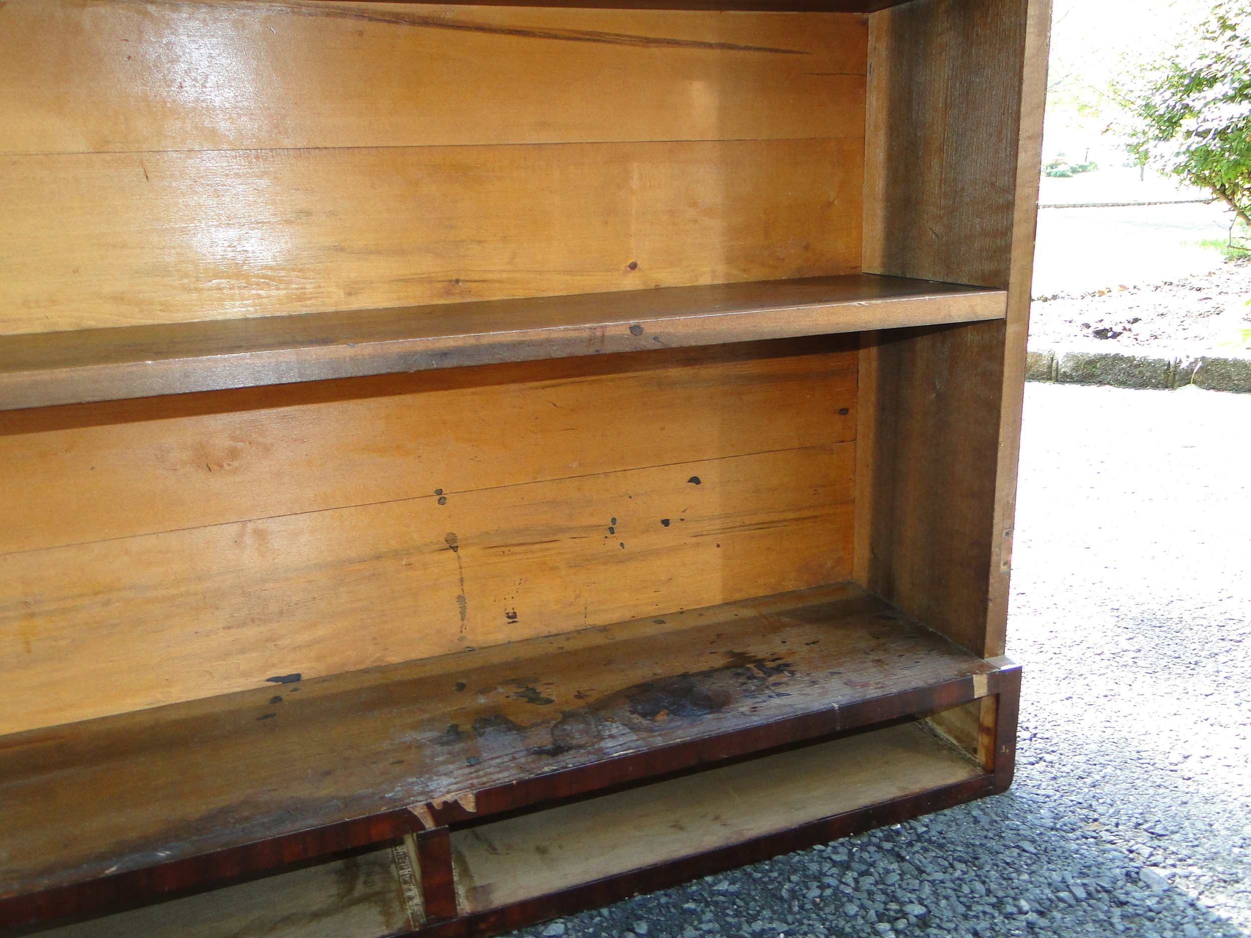 """""""Before"""" close up of marred shelves"""