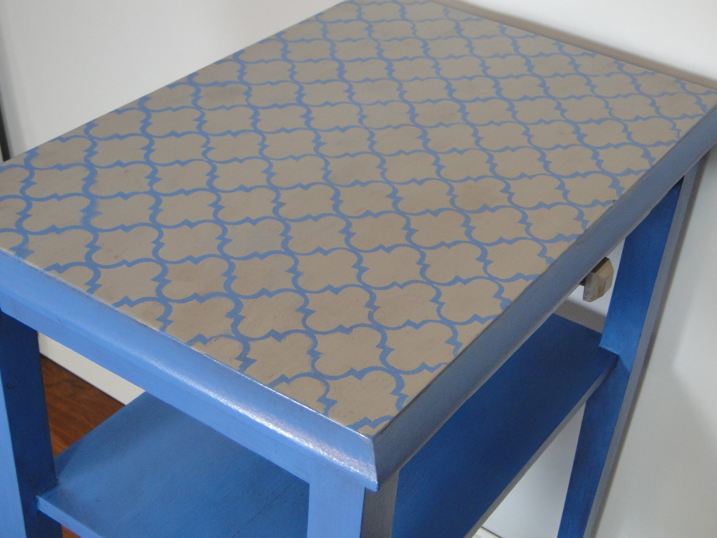 View of top of table with grey & blue stenciled design
