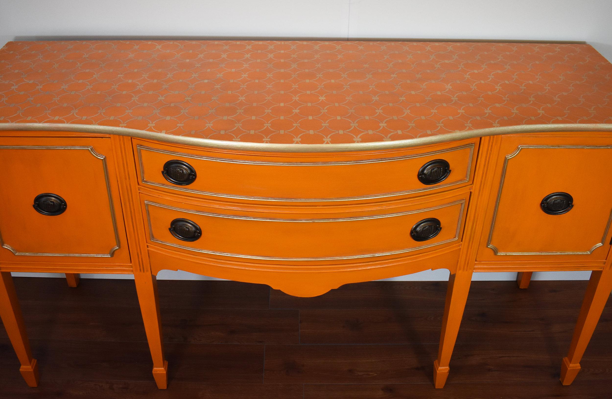 Custom details ... stenciled top, metallic moldings, repainted handles