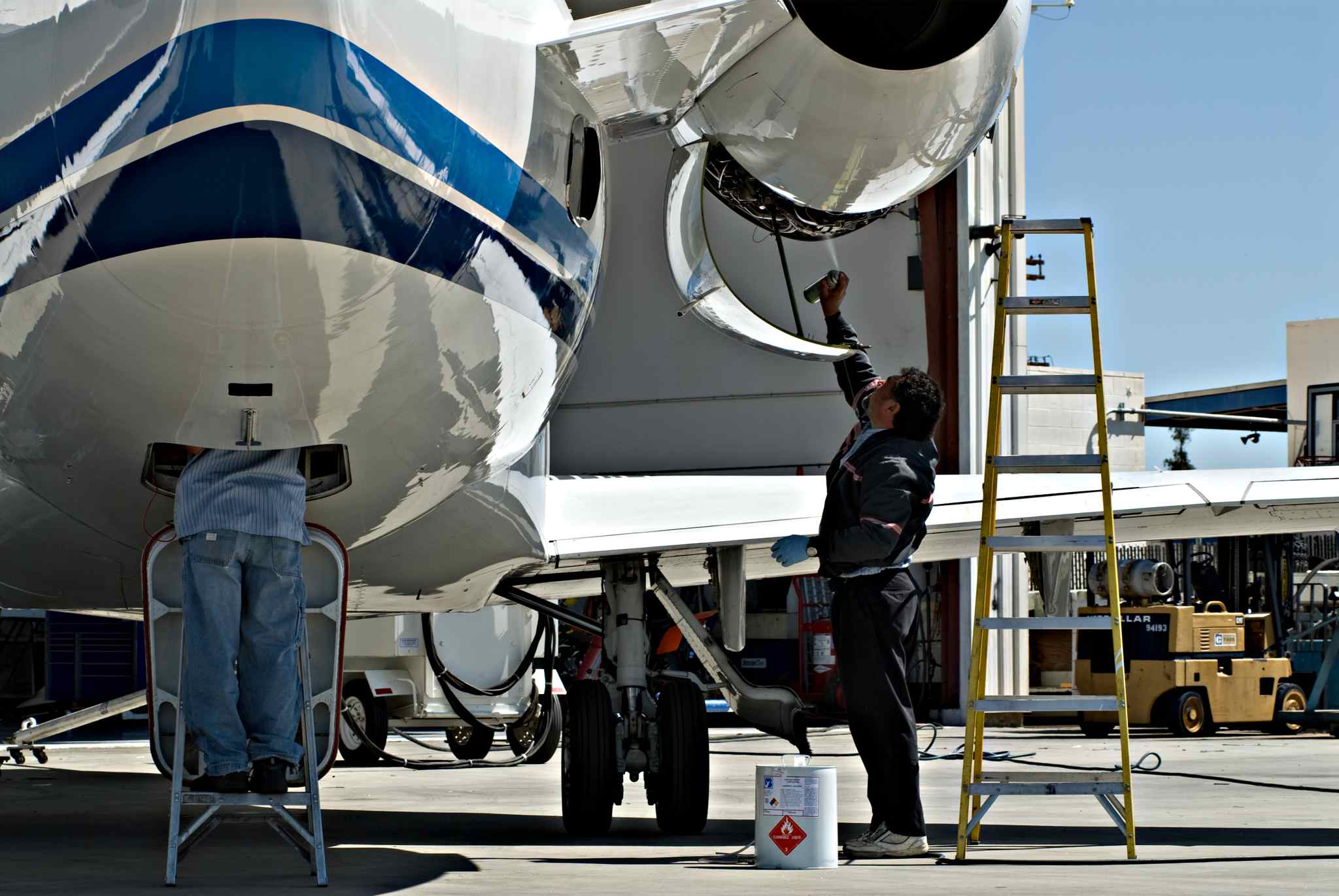 Technicians working on Challenger 600.