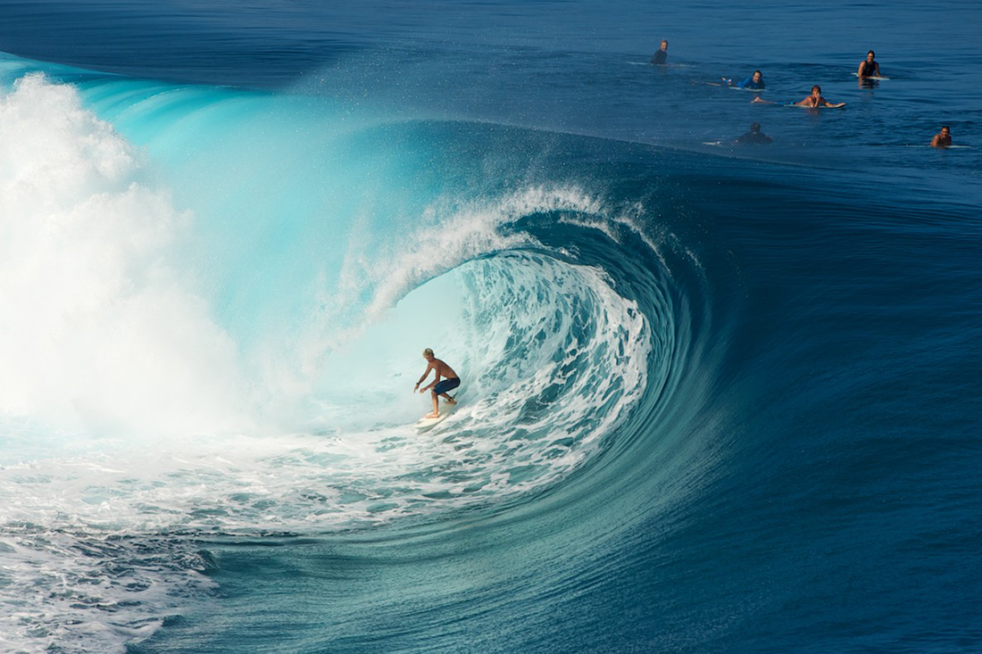 Surfing superwaves of Teahupo'o in Tahiti.