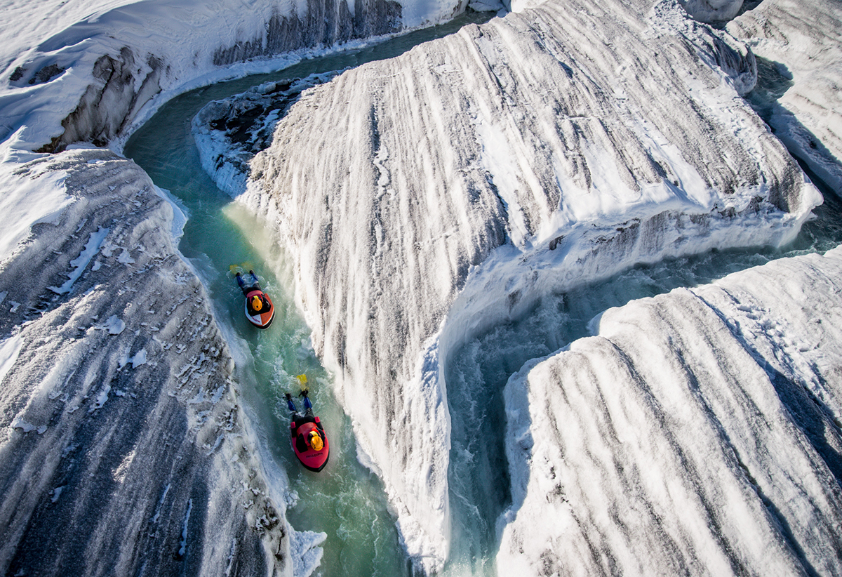 David Carlier photographs Claude-Alain Gailland and Gilles Janin hydrospeeding down the Aletsch Glacier
