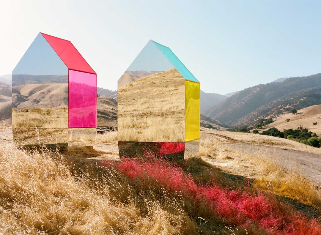 Seemingly floating Monopoly-like mirror houses designed by photographer and creative director  Autumn De Wilde .