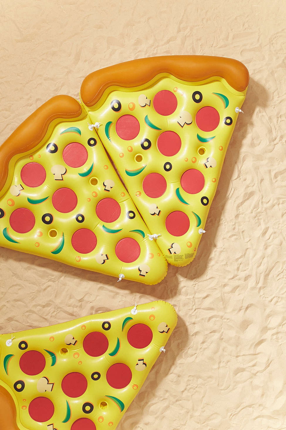 Pizza Slice Pool Float  by Urban Outfitters $46