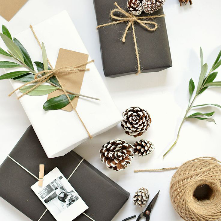 wrap your gifts in matte black gift wrap with leaf