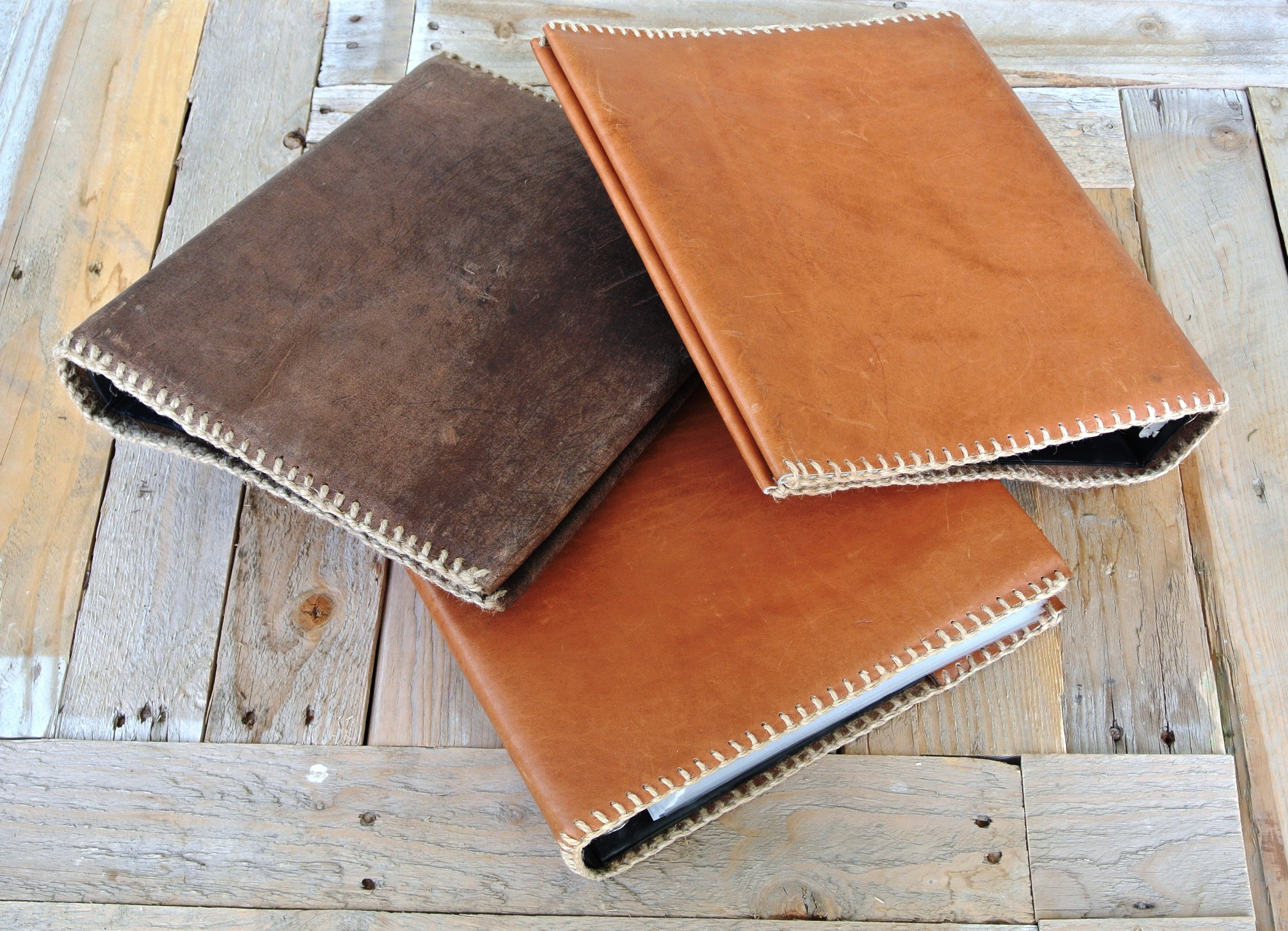 Circle M Brand leather binders.JPG
