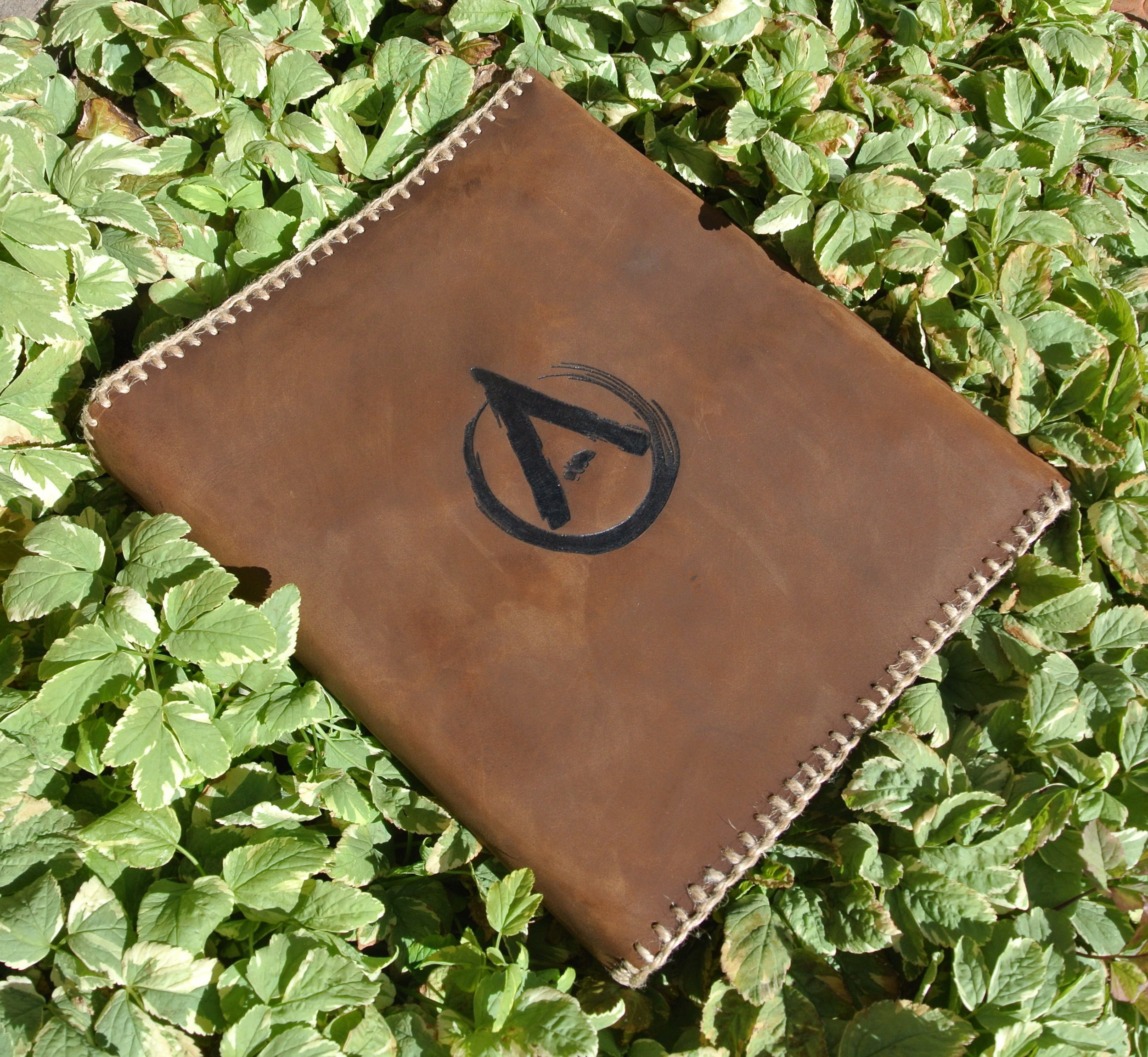 Circle M-Brand - custom leather binder cover.JPG