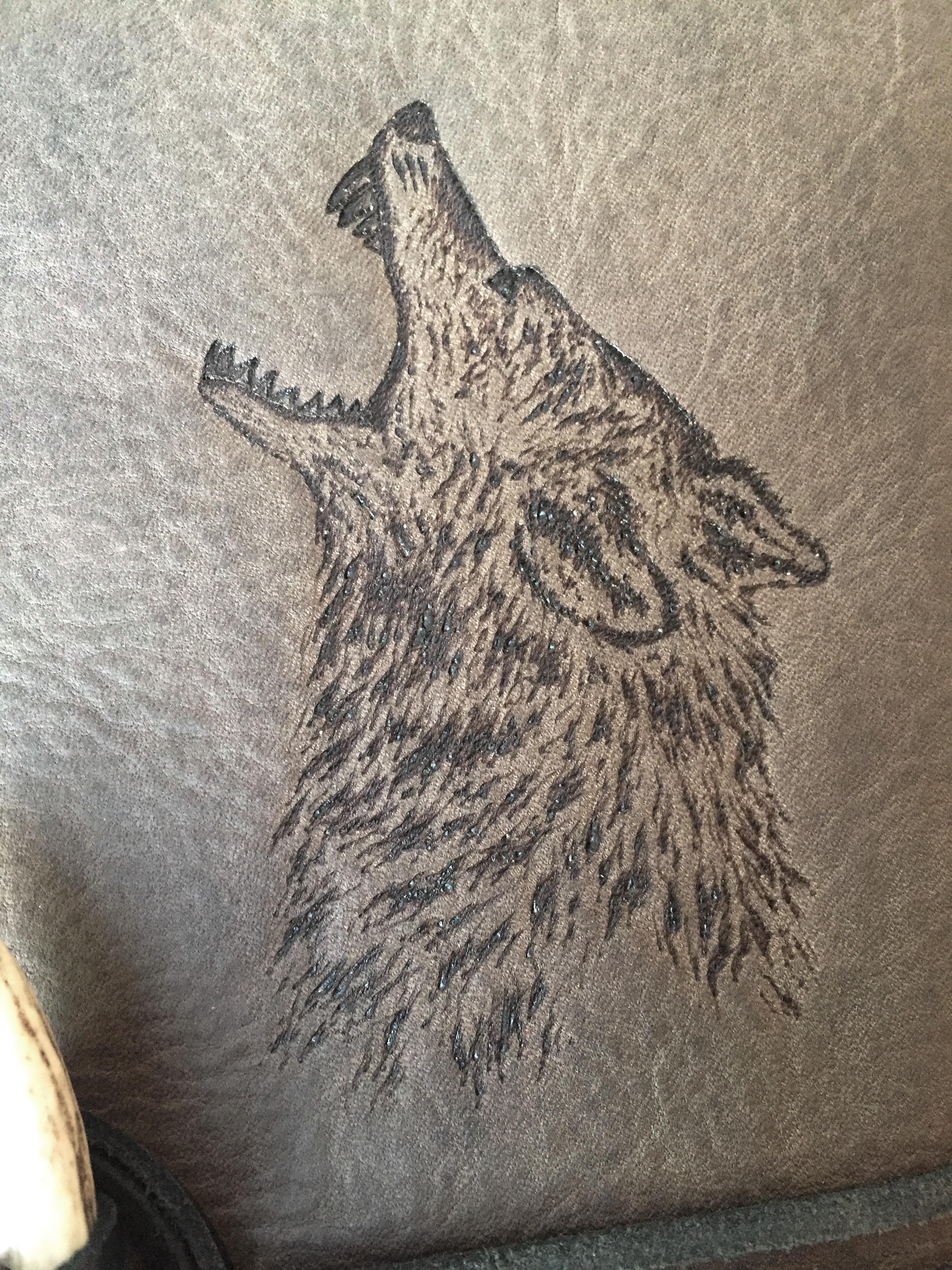 Circle M Brand - Wolf engraving.JPG