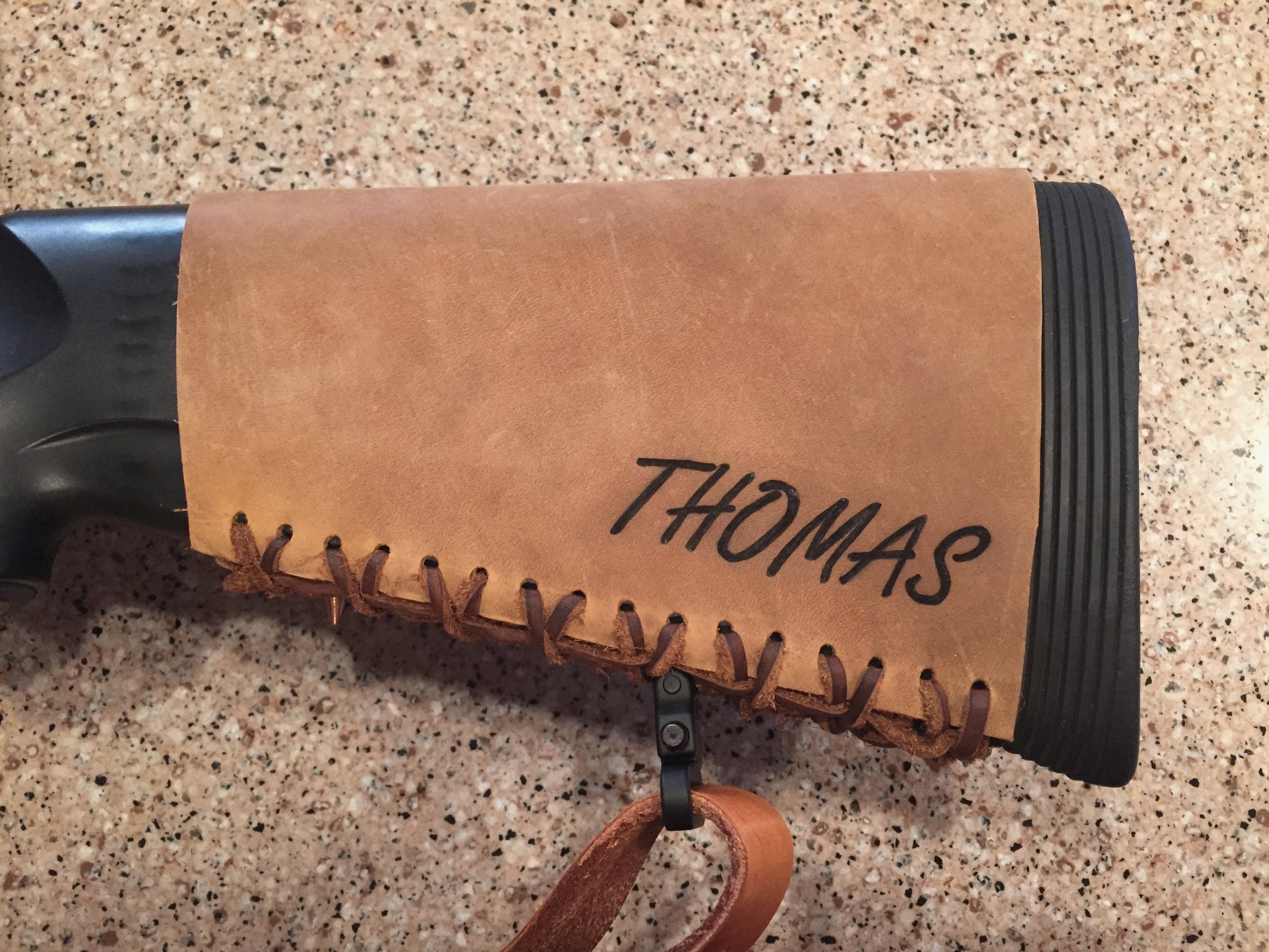 Circle M Brand - custom Leather Buttstock Cuff with Name Heat Engraved.JPG