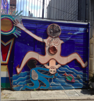 Mural by  Susan Cervantes ,  Mia Gonzales,  and others