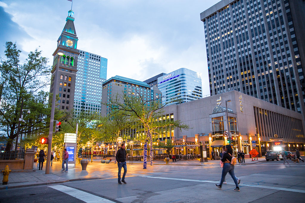 Denver, Colorado, USA - May 1, 2018:  Street scene along the 16th Street Mall in downtown Denver Colorado at night with lights and people in view