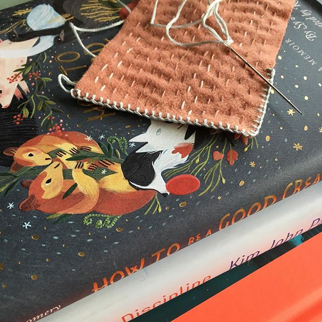Stitching up a little rug for a dollhouse that Michael is making for my daughter's birthday, and deciding which eye candy to flip through from my birthday book stash when I'm done