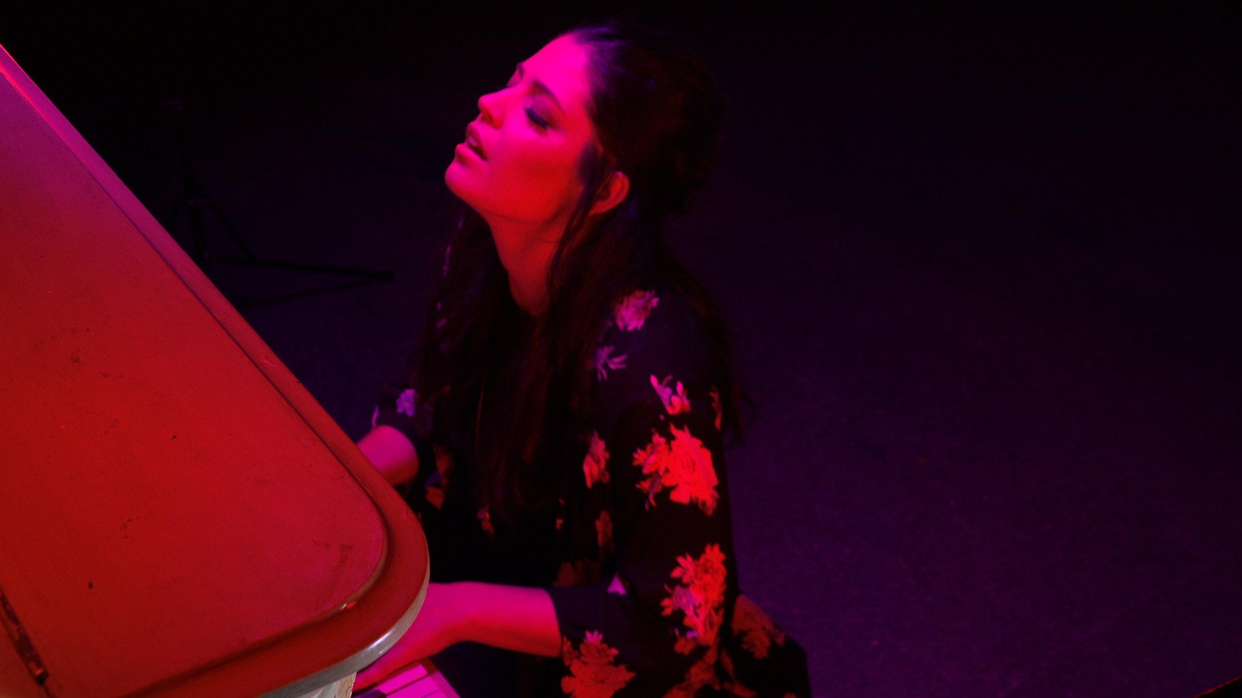 Beth red piano.jpg