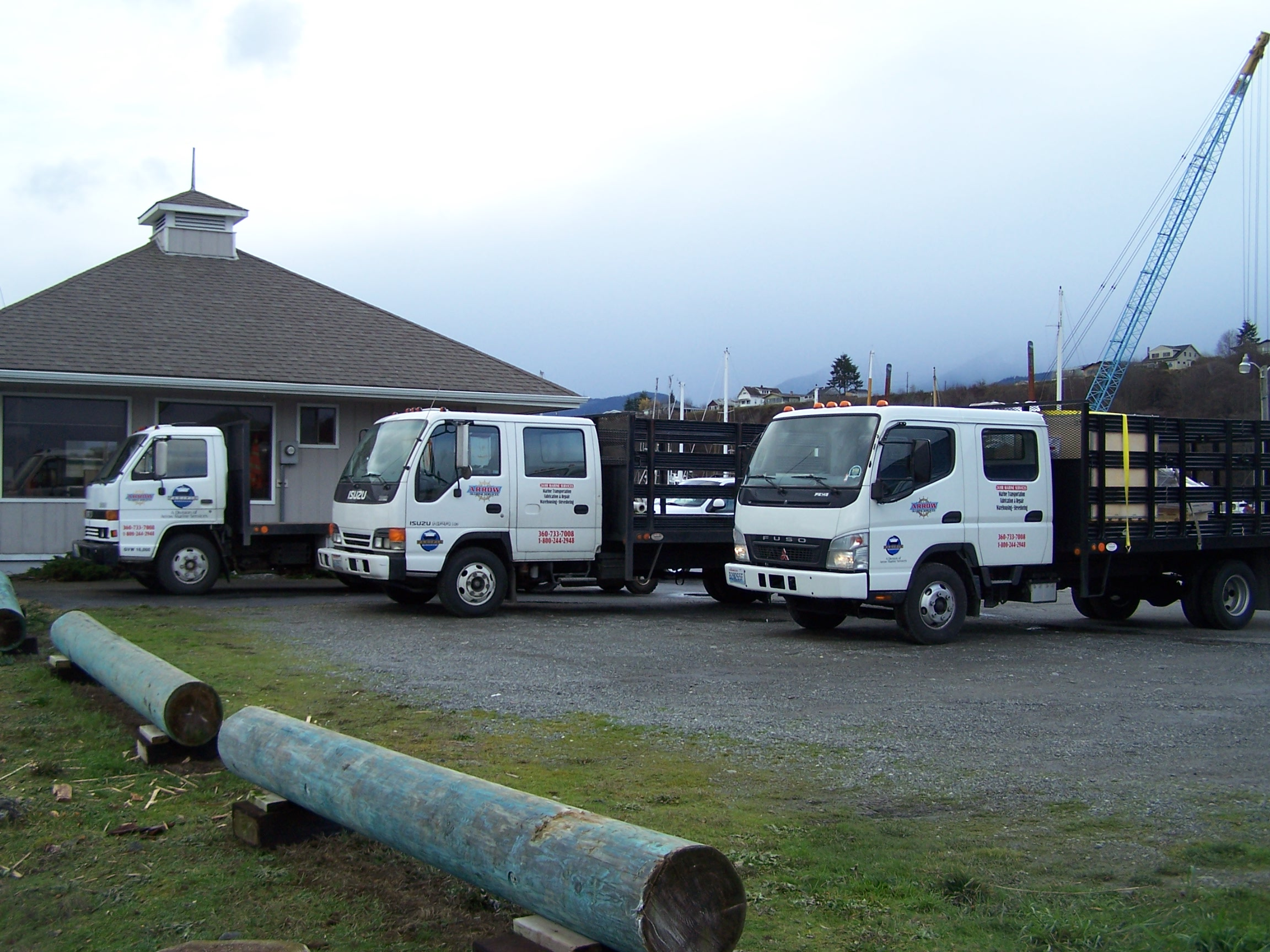 Arrow Marine moves your freight, three trucks parked across