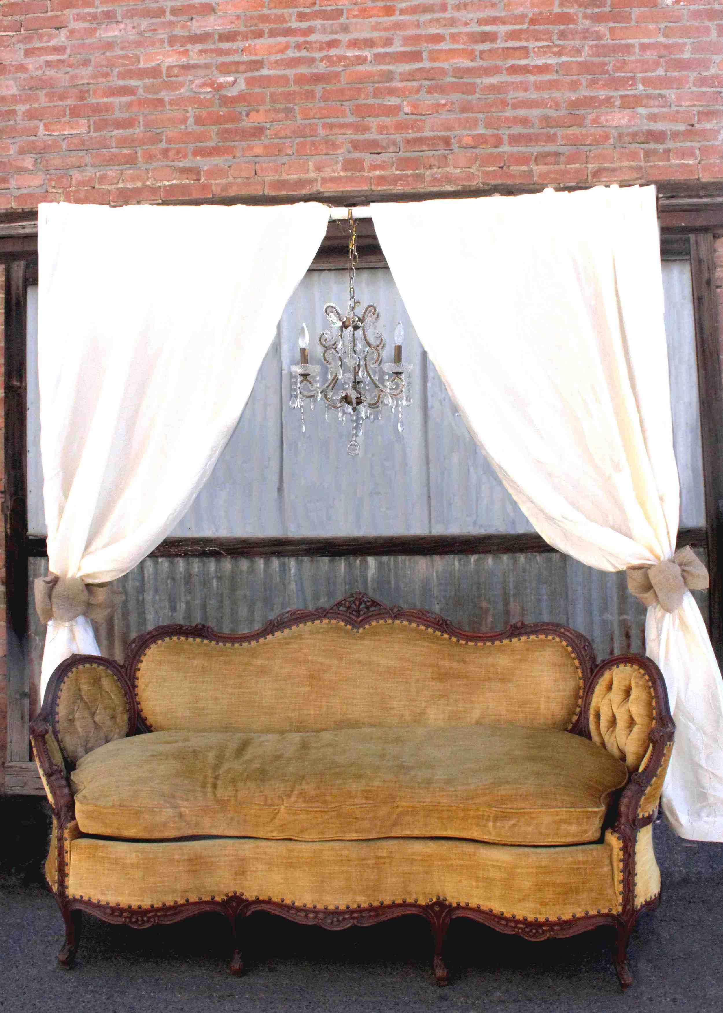Belle couch and Prim design burlap bows, chandelier and drapes