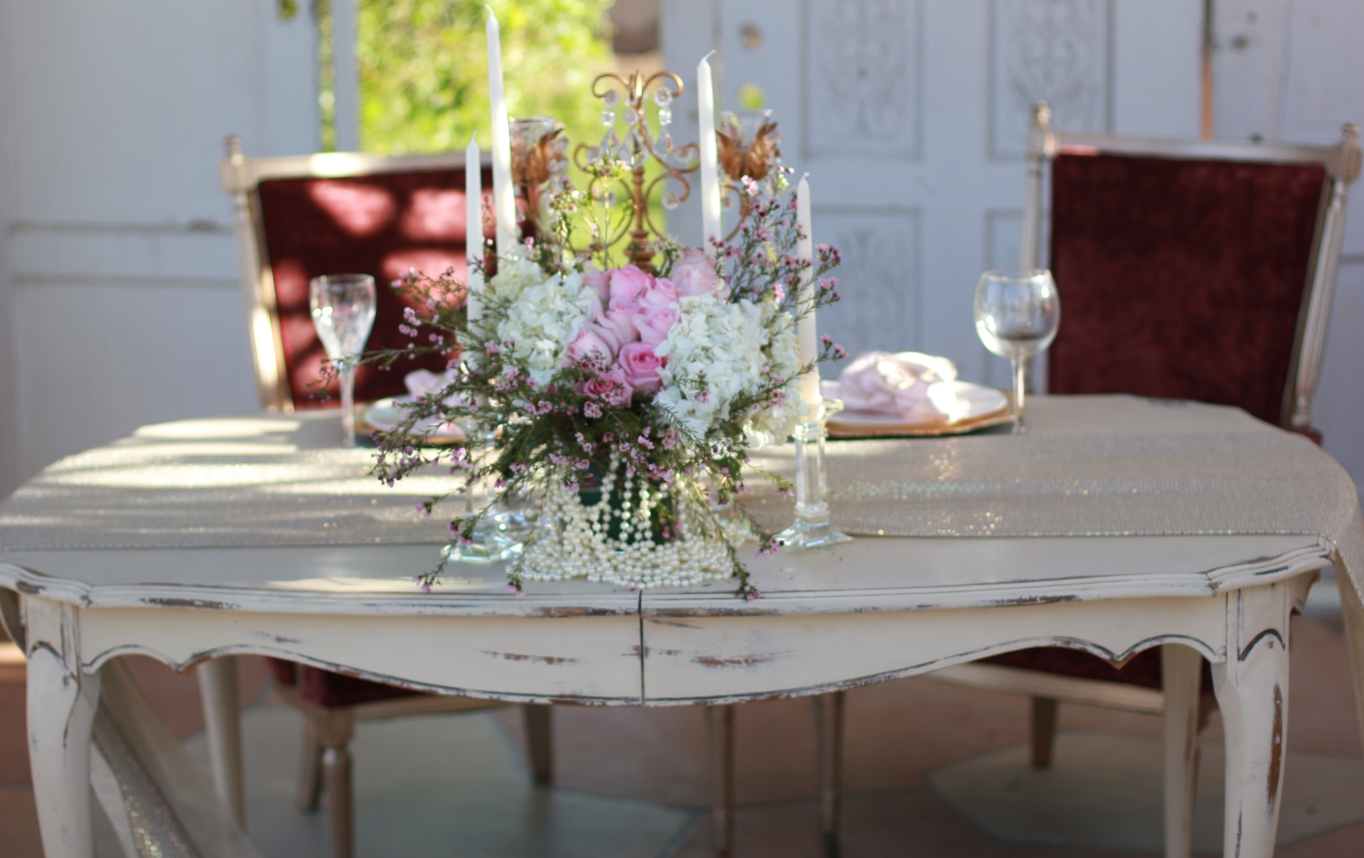 Cesar and Cleo chairs with Vivienne sweetheart table and Prim centerpiece design