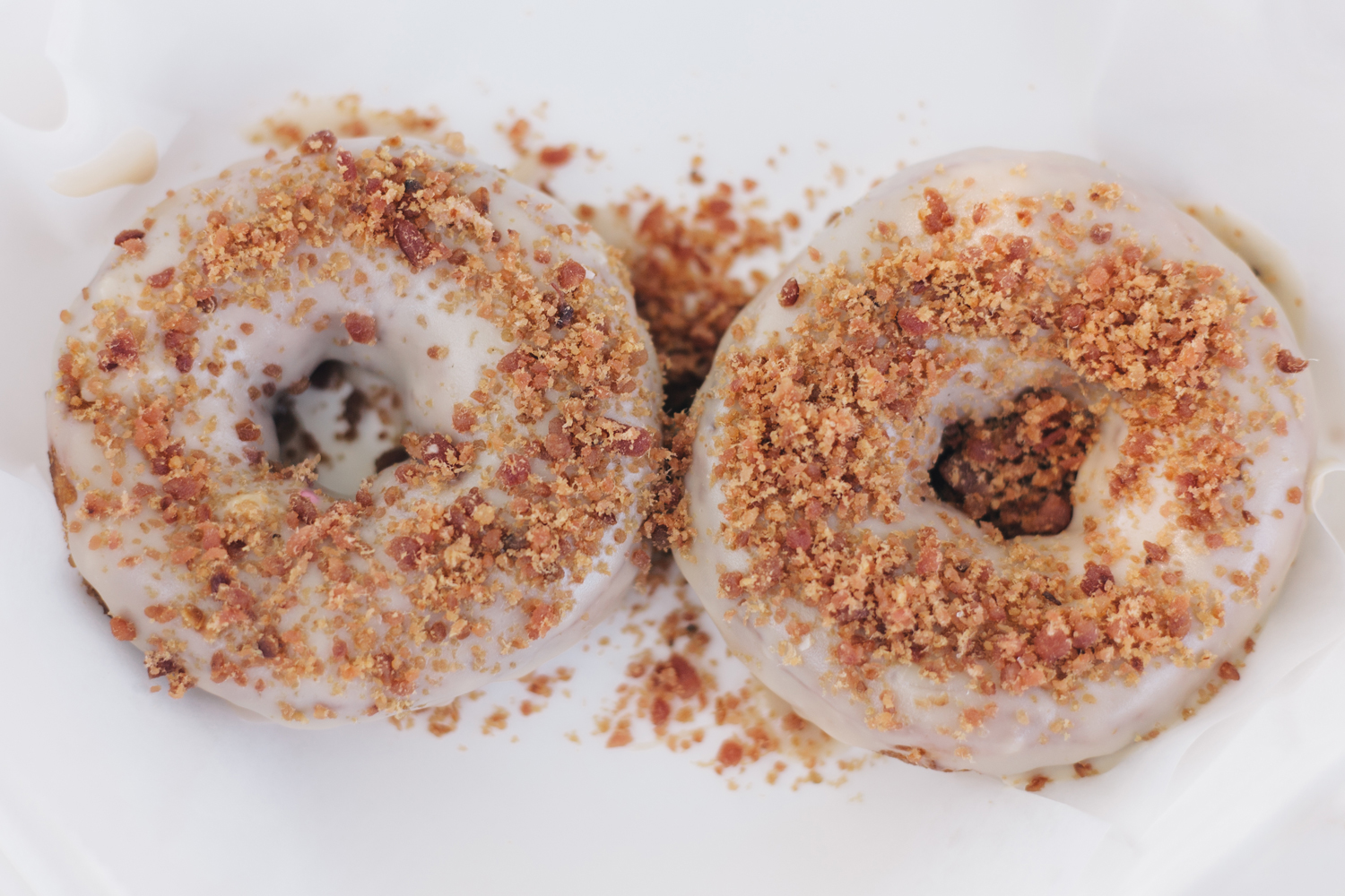 Duck Donuts  in Duck, North Carolina. Maple Frosted Doughnut with Bacon served piping hot.