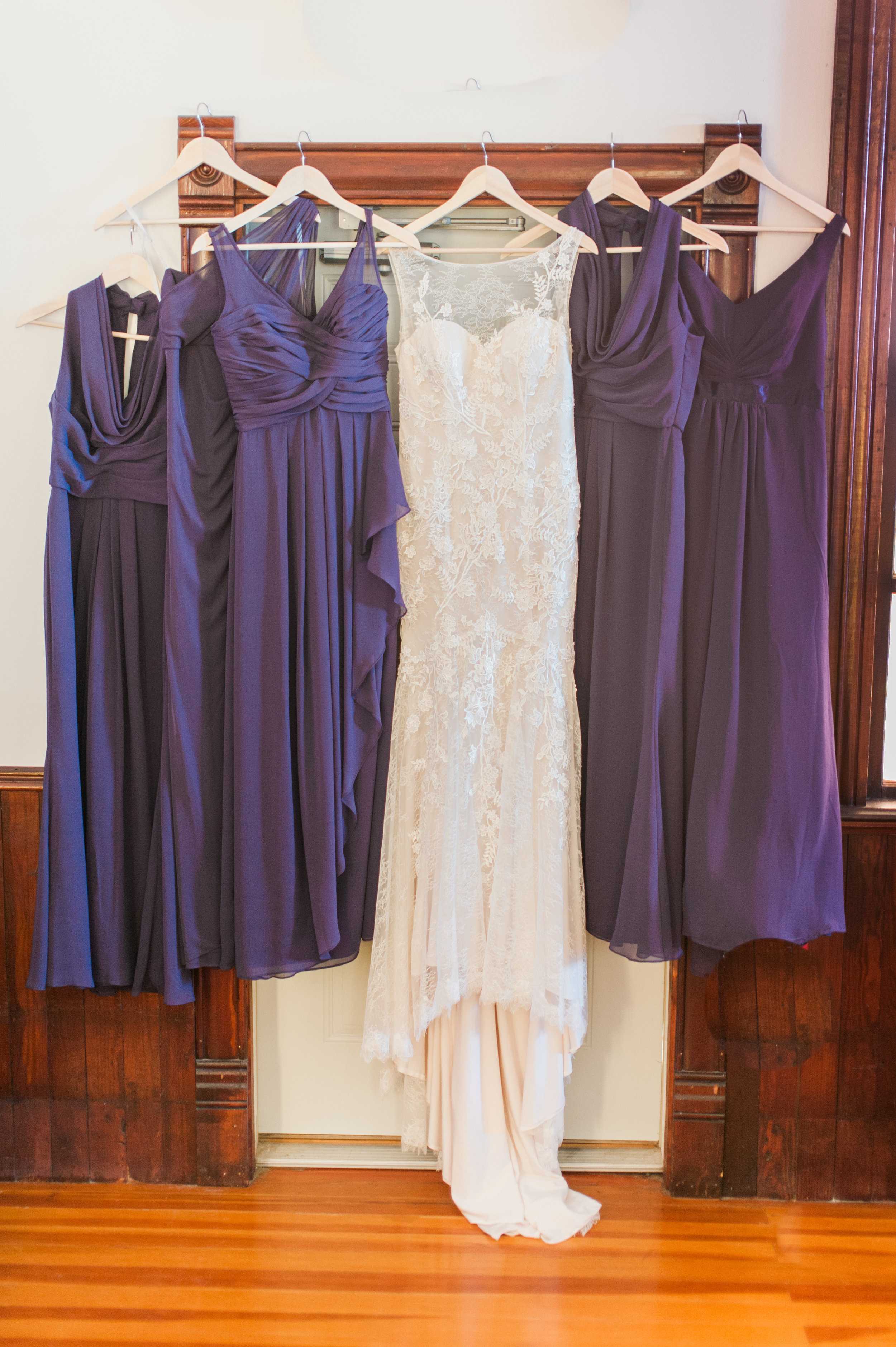 Bridesmaid dresses and bridal gown hanging for getting ready images in Elk City Chapel near Omaha Nebraska
