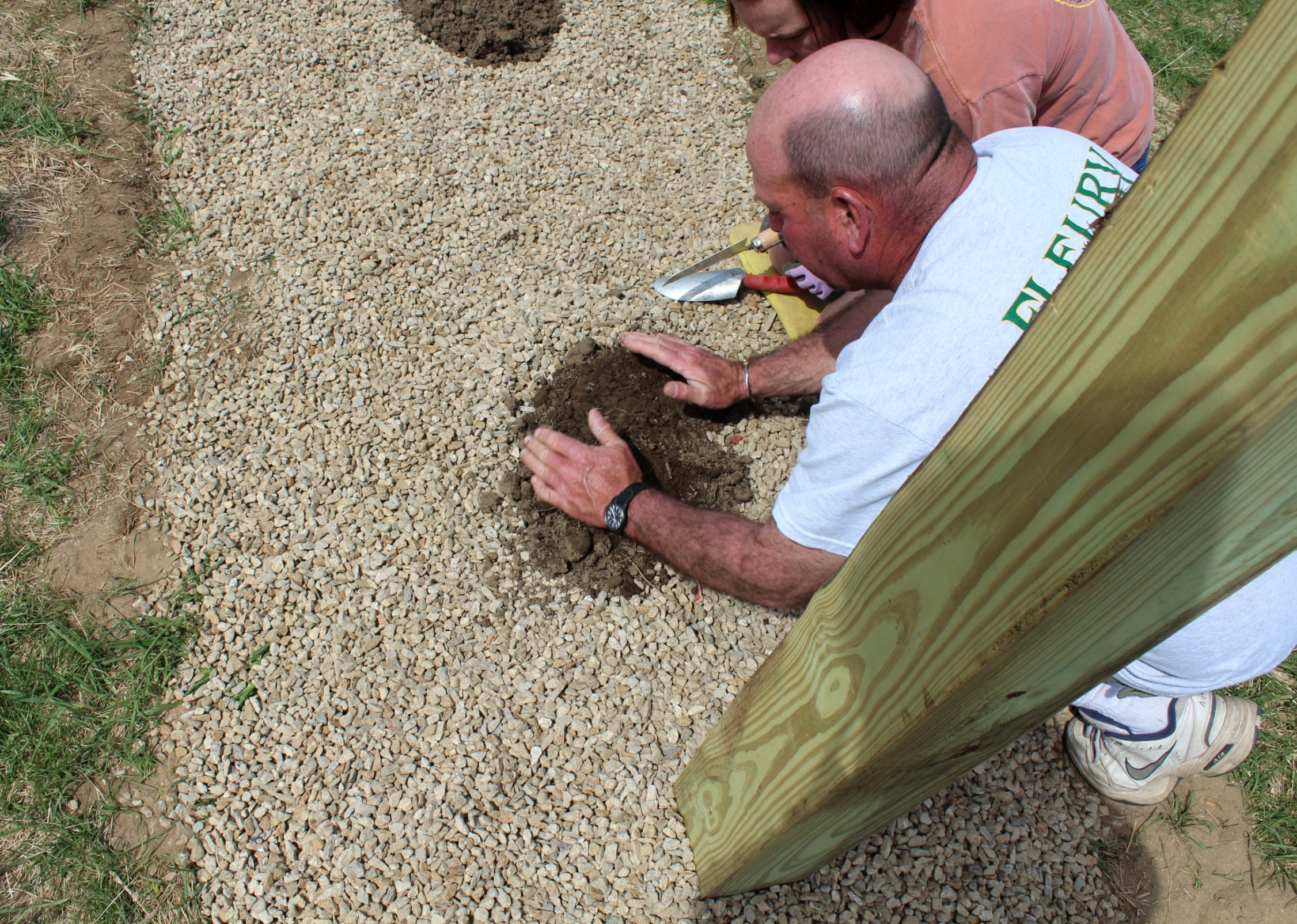 Dave and his wife, Mary, planting the first hop