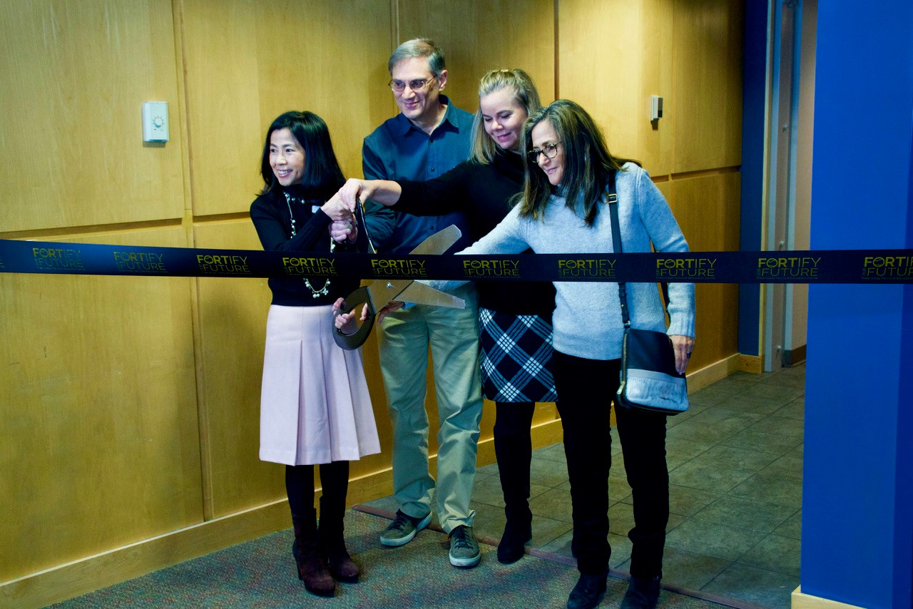 Executive Director Esther Tsai, Capital Campaign co-chairs Rick Rinkoff and Michele Mingo and Fred Wells' daughter Wendy Wells handled the ribbon cutting honors.