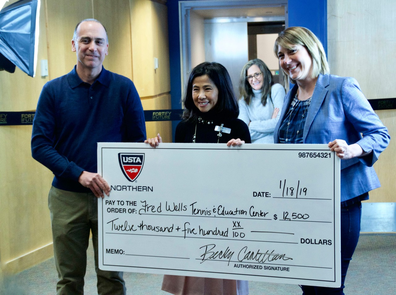 Esther Tsai accepts a check for $12,500 from USTA Northern's John Chandler and Becky Cantellano for the Capital Campaign.
