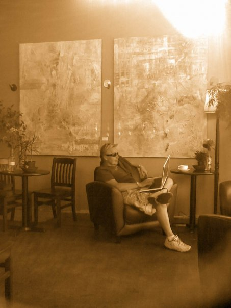 Scotty at his favourite coffee joint in Vancouver - 2007 - sitting by two of his abstracts.