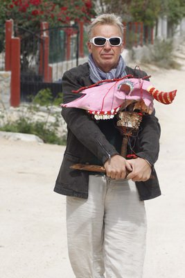 Scotty carrying his self portrait through the streets of Mexico in 2008.
