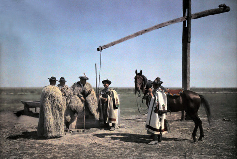 1932, Hungary --- Cowboys in sheepskin and a horse center around a well in the puszta --- Image by © Hans Hildenbrand/National Geographic Society/Corbis