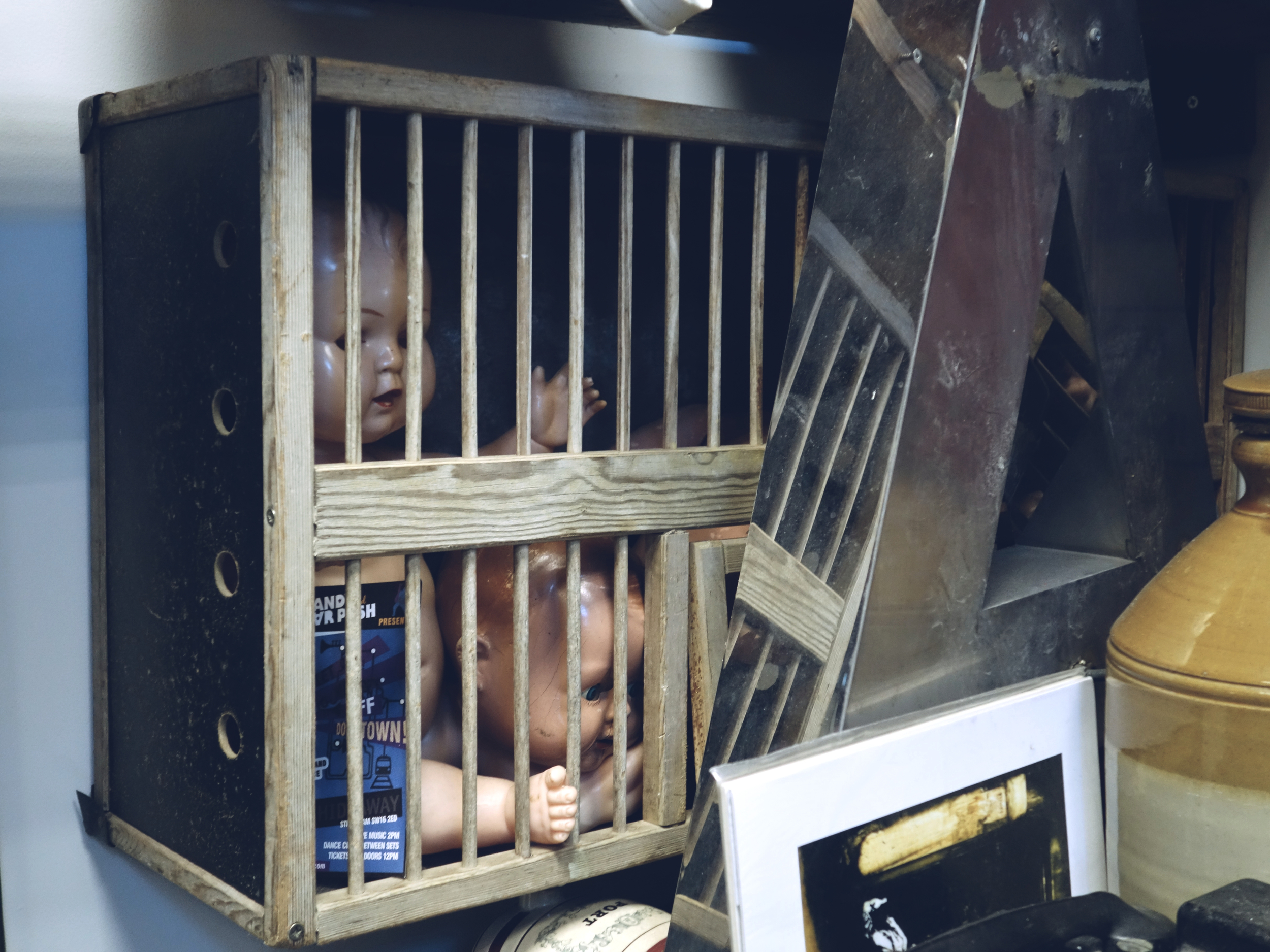 Dolls in a cage