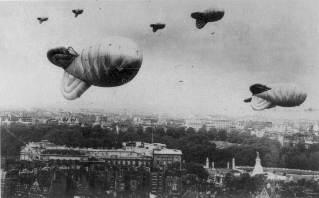 Photograph  of Barrage balloons over London during the Second World War. Buckingham Palace and the Victoria Memorial can be seen in the middle ground.