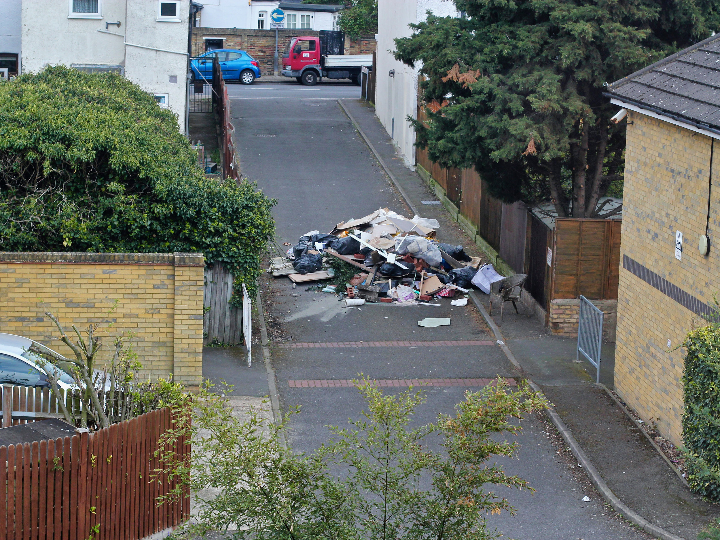 11.30 on Saturday morning and a truckload of waste is fly-tipped onto a residential access road. The offending vehicle is gone within a couple of minutes.