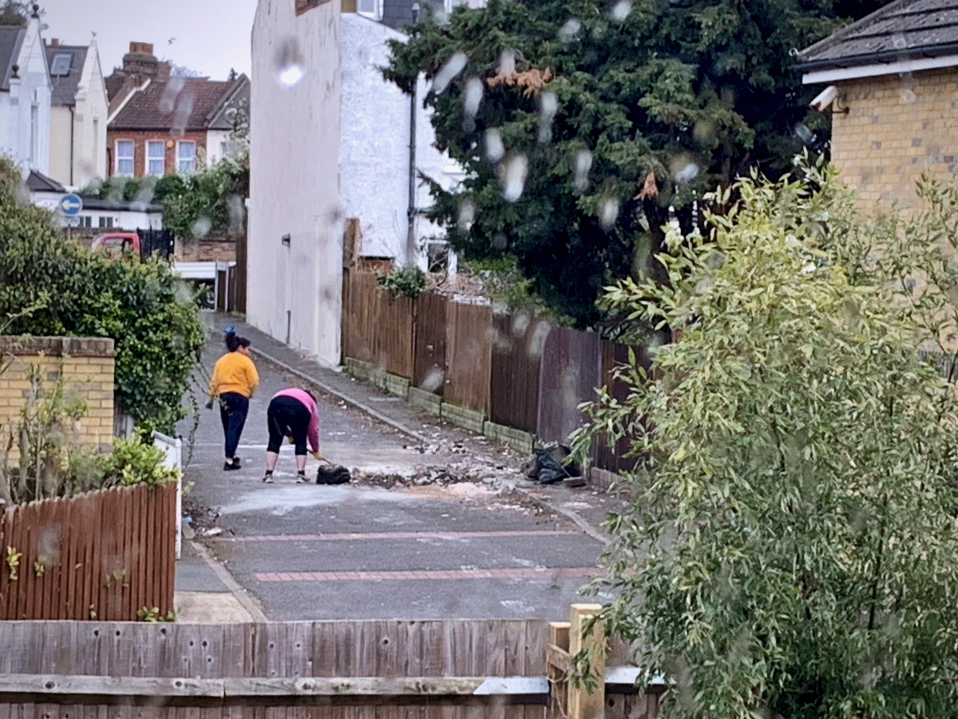 A week after the load was dumped, some very neighbourly people try and remove the remnants of the debris that coats the road.