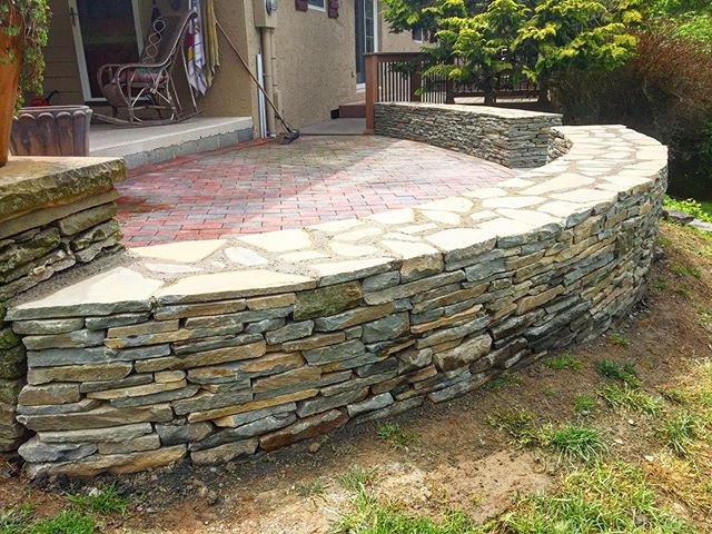 Dry stock retaining wall & brick patio restoration by @americanstonels