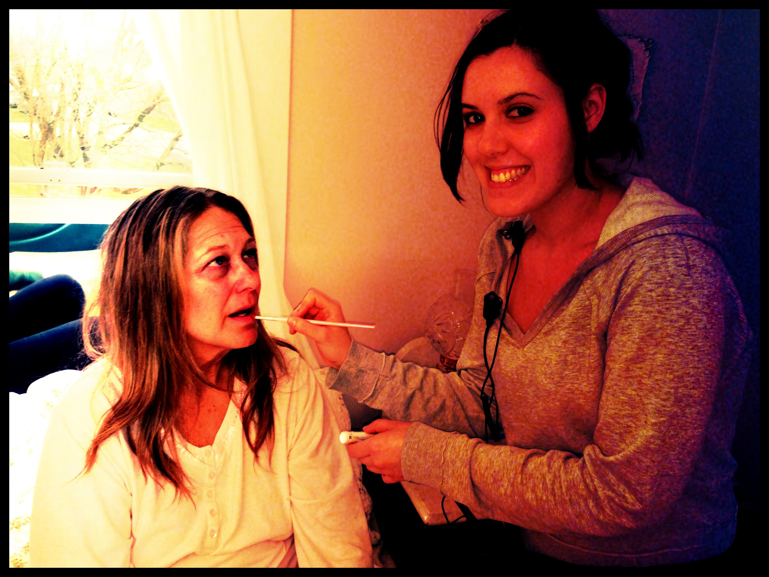 Jen touching up actress Nancy Sellers right before her call to set