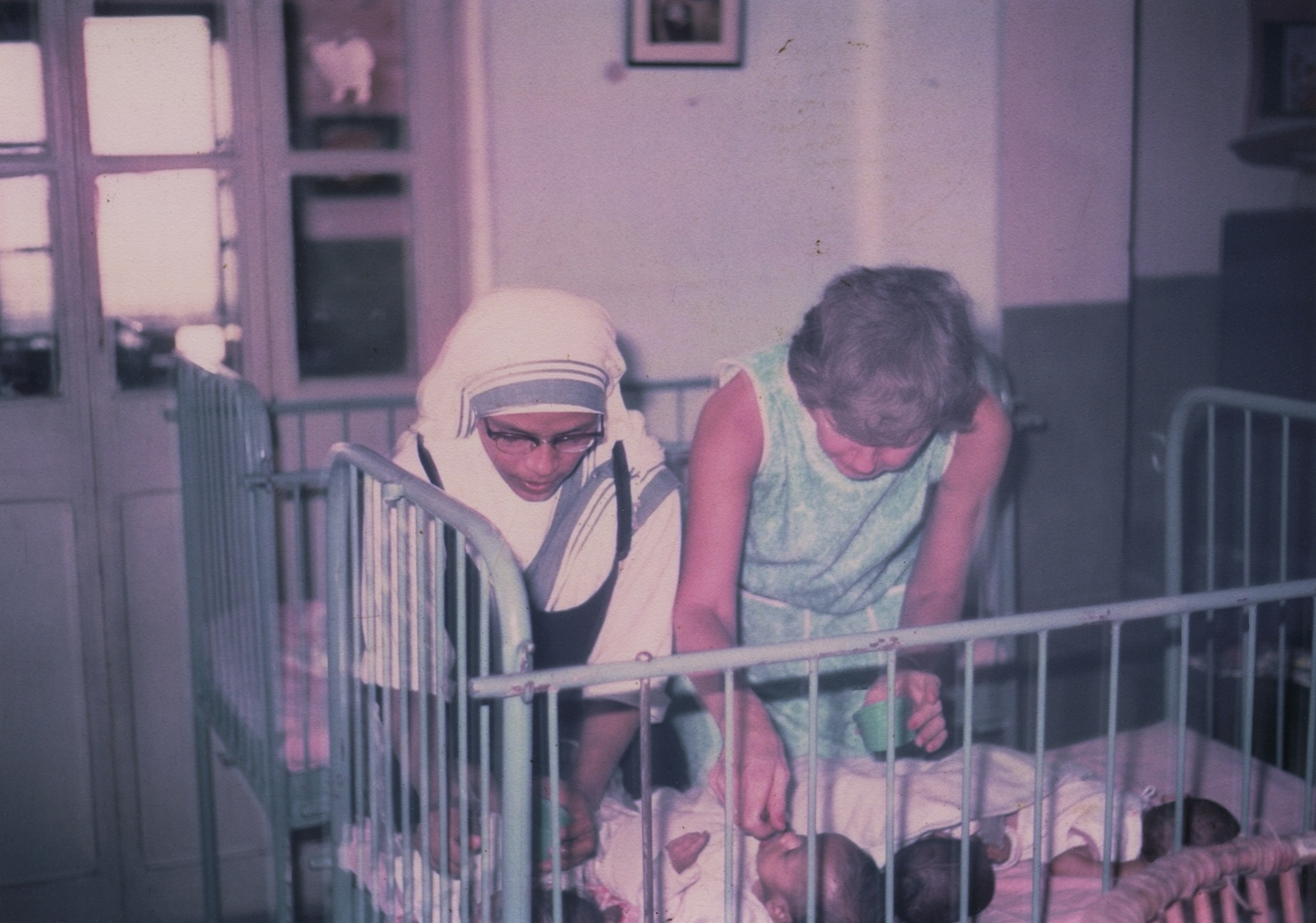 1968 One of Mother Teresa's Sisters and Eleanor McPhillips tend to orphans at the Missionaries of Charity in Kolkata, India.