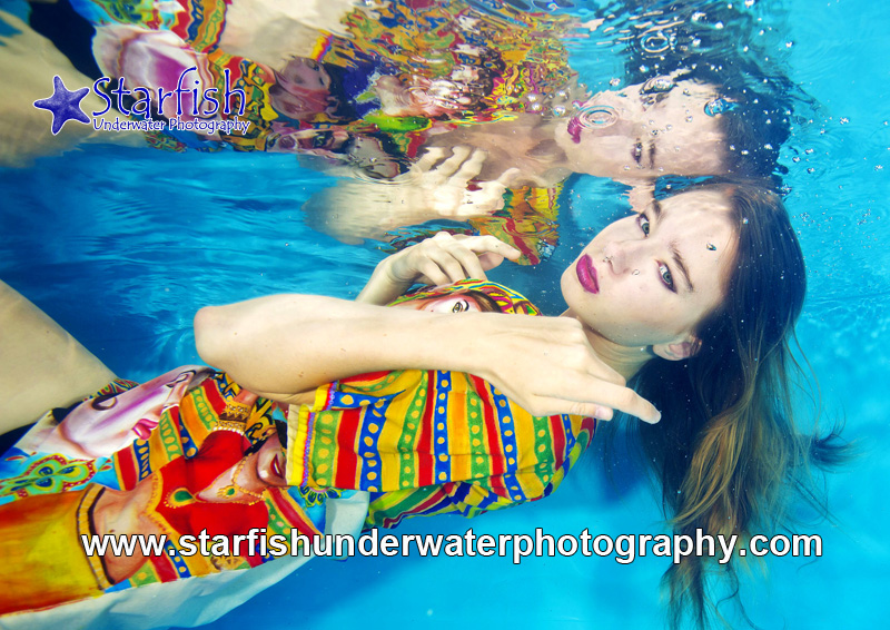 Emily Rose Arno models a hand painted dress by creativeplanets underwater.