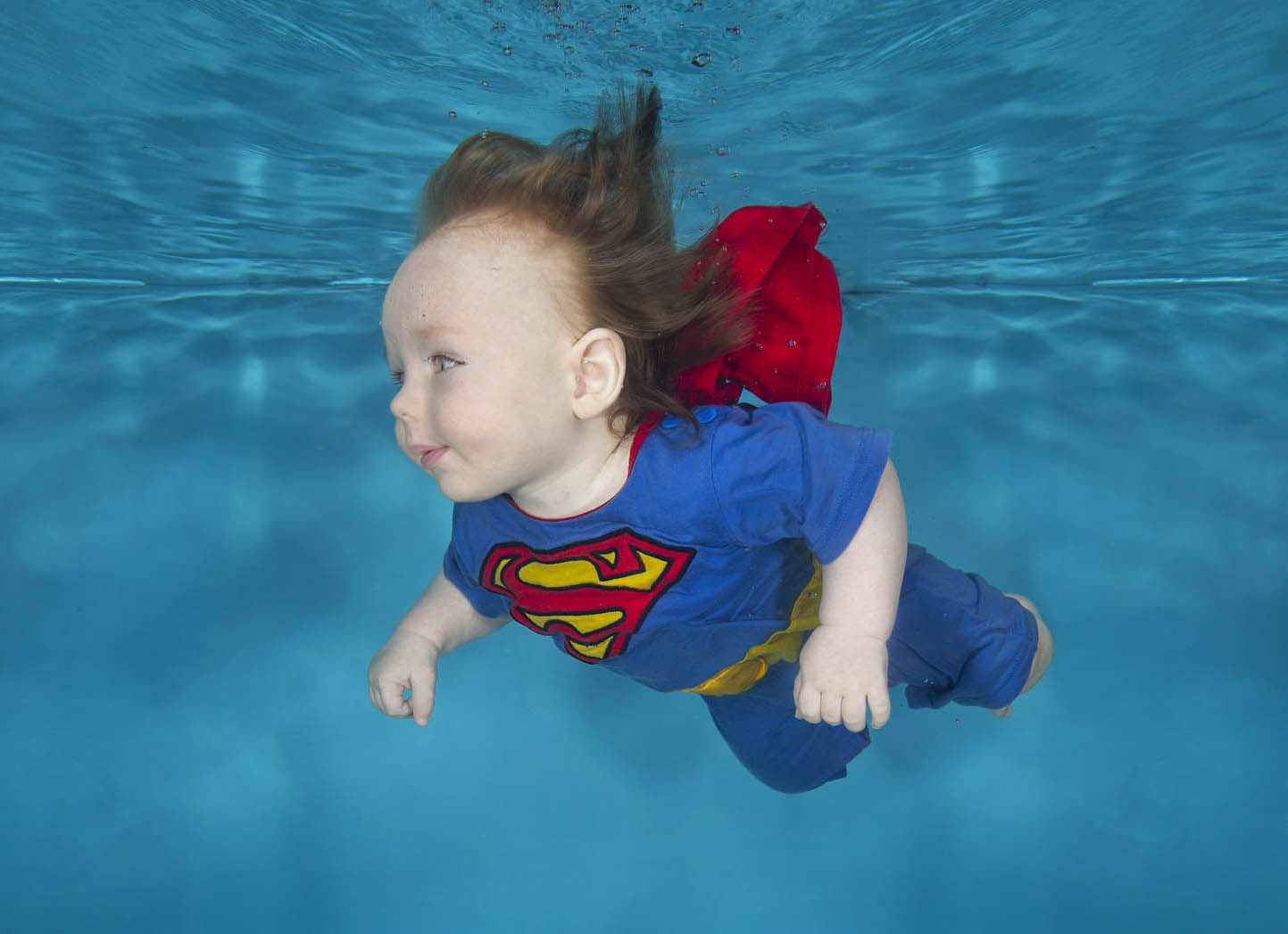 Super baby underwater! This is one of our costumes so you can try this shot too!