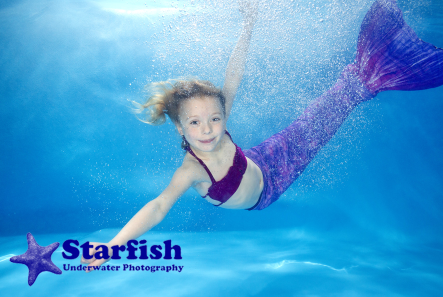 Imogen Barker, 5, makes a splash as a mermaid, at an underwater photo shoot, with Little Fishes Swim School in Clophill.
