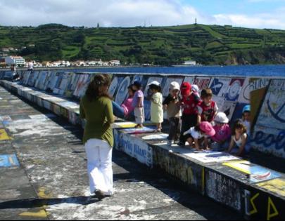 Maritime artwork lining the city walls
