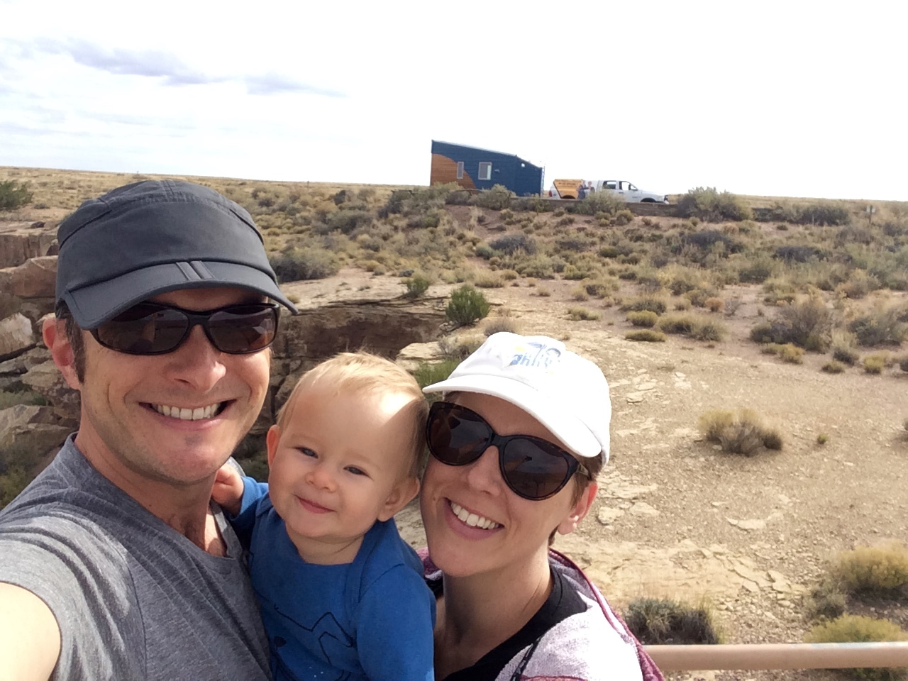 Corbett, Nanette, and Grace with #TinyLab in the background at the Petrified Forest in Arizona.