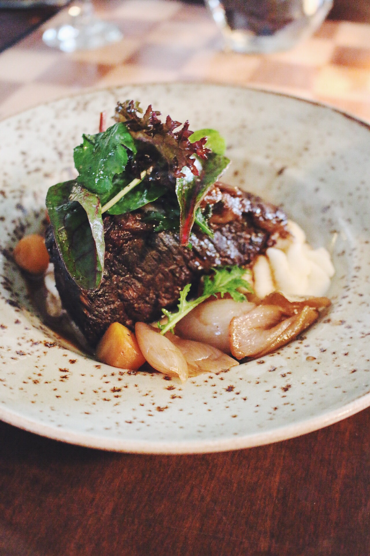 Red wine braised short rib with root vegetables