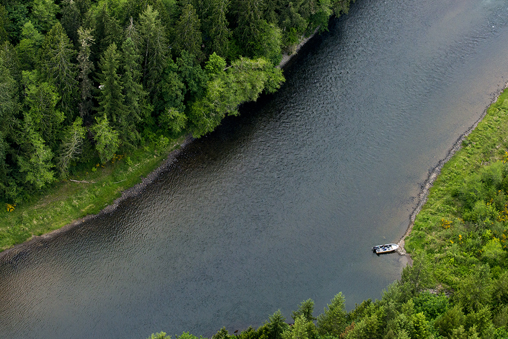 Anglers in a boat in the Cowlitz River below the Barrier Dam near Ethel, Wash.