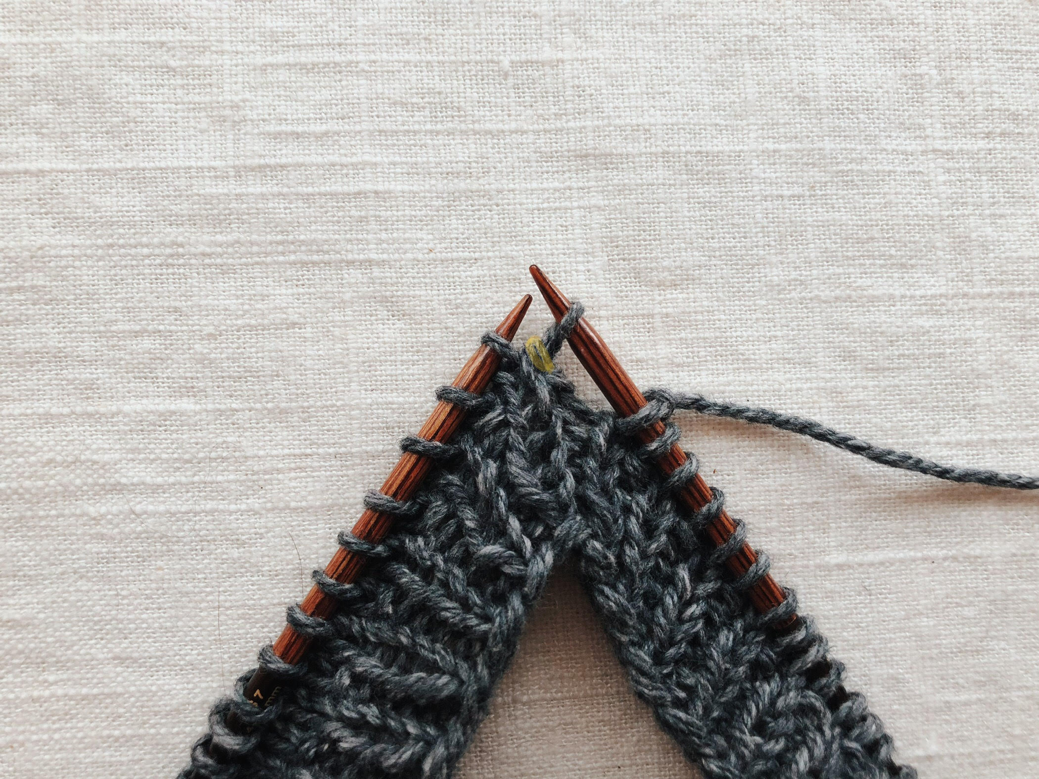 Transfer the stitch from the left needle to the right needle, exposing the slipped stitch (highlighted)