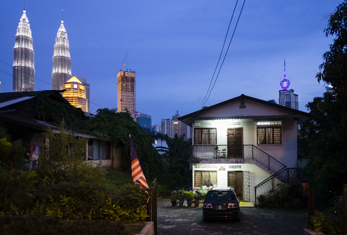 The Petronas Towers with KL Tower on the right as seen from Kampung Baru, Kuala Lumpur.