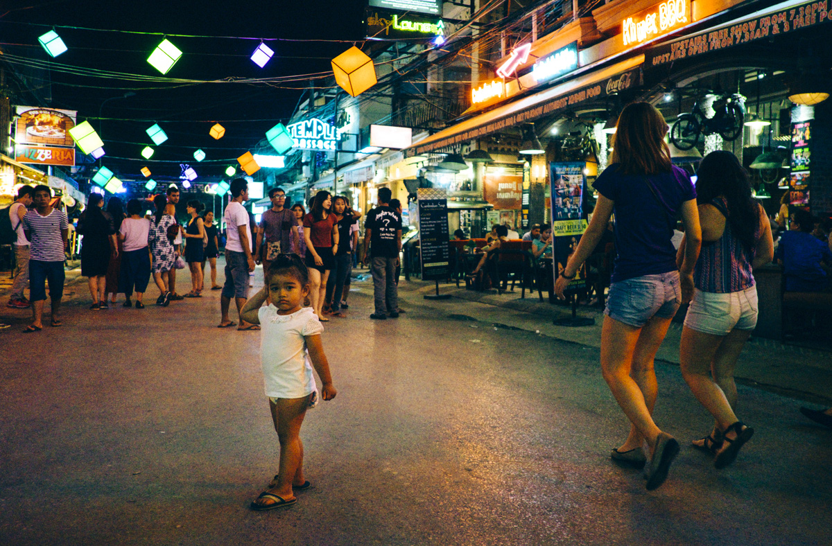 Past her bed time. Pub Street Siem Reap, Cambodia.
