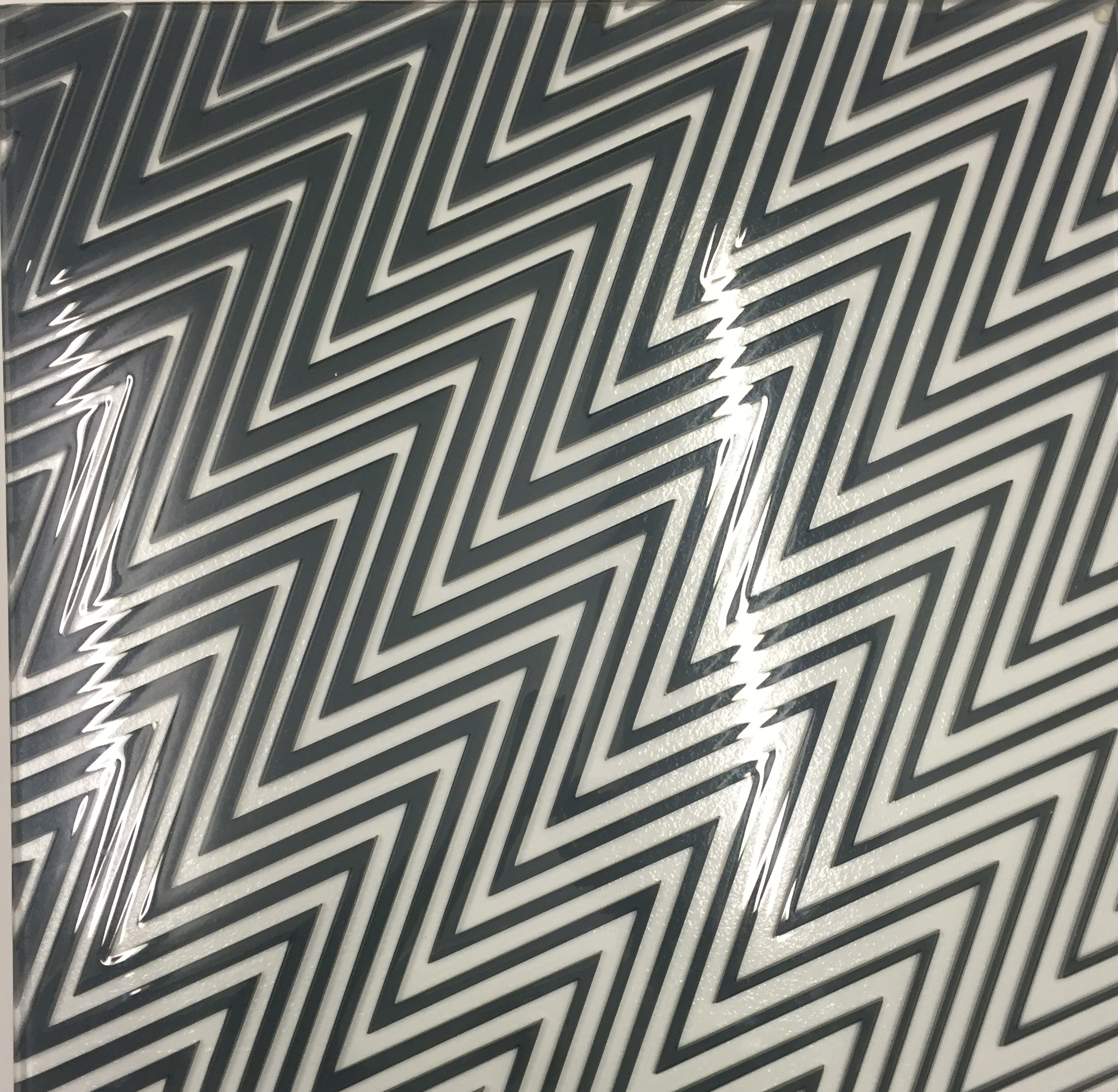 This creates a transparent sheet, the edges of which are polished using diamond tools before a penultimate process of industrial laminating to comply with British Standards.
