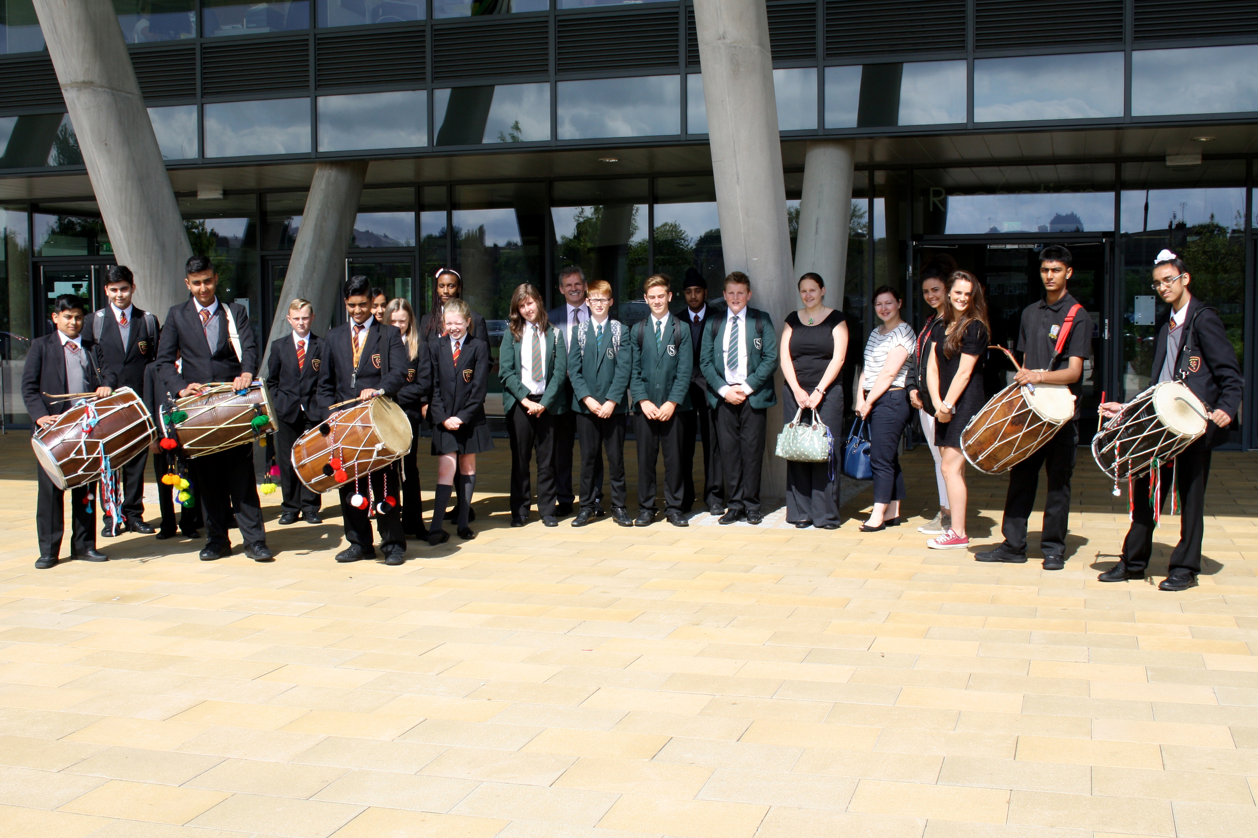 Photograph: Highfields' student guides, accompanied by Mr Jevon and a performance by our Dhol Drum group, greeted our visitors from Southam College.